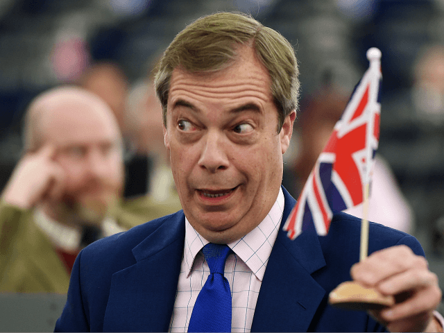 Former UK Independence Party (UKIP) leader, Brexit campaigner and member of the European Parliament Nigel Farage holds a little Union flag as he attends a debate on the preparation of the upcoming European Council meeting of March 21 and 22 and UKs withdrawal from the EU during a plenary session …