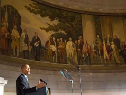 Obama in front of founding fathers