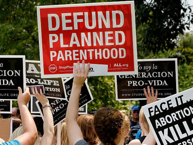 Anti-abortion activists hold a rally opposing federal funding for Planned Parenthood in front of the U.S. Capitol on July 28, 2015 in Washington, DC.