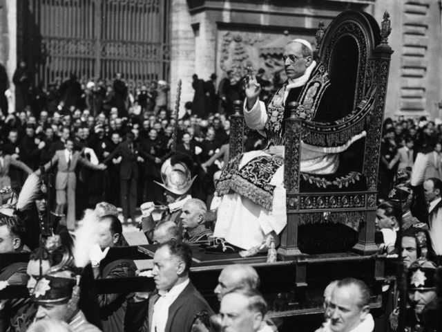 Pope Pius XII (1876 - 1958), Eugenio Pacelli, being carried through a crowded piazza. (Photo by Keystone/Getty Images)