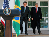 President Donald Trump and Brazilian President Jair Bolsonaro arrive for a news conference in the Rose Garden of the White House