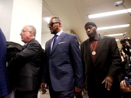 Second from left, singer R. Kelly arrives at the Daley Center for his hearing, on March 6, 2019 in Chicago, Illinois. Singer R. Kelly arrives at the Daley Center for his hearing on March 6, 2019 in Chicago, Illinois. Kelly was in court after failing to pay more than $160,000 …