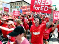 PHOENIX, AZ - APRIL 26: Thousands of Arizona teachers march through downtown Phoenix on their way to the State Capitol as part of a rally for the #REDforED movement on April 26, 2018 in Phoenix, Arizona. Teachers state-wide staged a walkout strike on Thursday in support of better wages and …