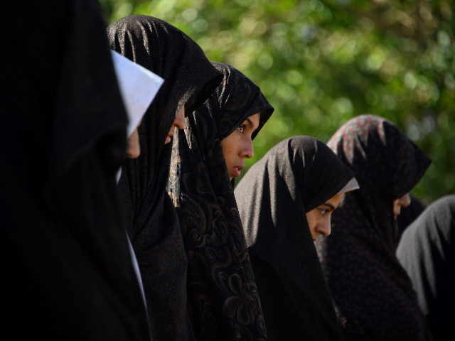 Afghan Muslim women offer prayers at the start of Eid al-Fitr which marks the end of the holy month of Ramadan, in Herat on June 15, 2018.