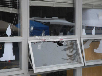 In this handout crime scene evidence photo provided by the Connecticut State Police, shows a damaged window at the Sandy Hook Elementary School following the December 14, 2012 shooting rampage, taken on an unspecified date in Newtown, Connecticut. A second report was released December 27, 2013 by Connecticut State Attorney …