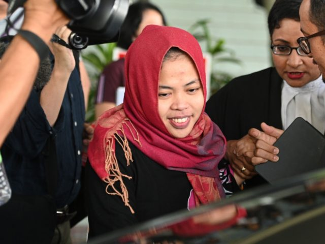 Indonesian national Siti Aisyah (C) smiles while leaving the Shah Alam High Court, outside Kuala Lumpur on March 11, 2019 after her trial for her alleged role in the assassination of Kim Jong Nam, the half-brother of North Korean leader Kim Jong Un. - An Indonesian woman accused of assassinating …