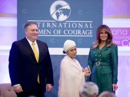 Razia Sultana of Bangladesh poses with Secretary of State Mike Pompeo and first lady Melania Trump as she is awarded the 2019 International Women of Courage at the Department of State in Washington, Thursday, March 7, 2019.