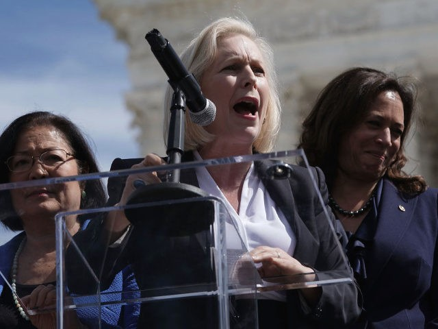 U.S. Sen. Kirsten Gillibrand (D-NY) (2nd L) speaks as Sen. Mazie Hirono (D-HI) (L) and Sen. Kamala Harris (D-CA) (R) listen during a rally in front of the U.S. Supreme Court September 28, 2018 in Washington, DC.