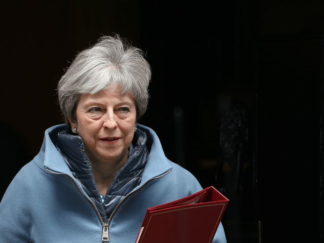 Britain's Prime Minister Theresa May leaves 10 Downing Street in London on March 25, 2019. - British Prime Minister Theresa May chaired a meeting of her cabinet amid reports of an attempted coup by colleagues over her handling of Brexit. (Photo by Isabel Infantes / AFP) (Photo credit should read …