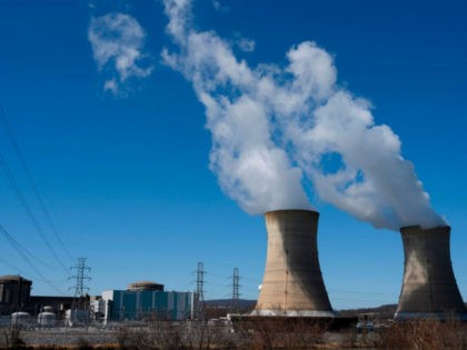 Power lines come off of the nuclear plant on Three Mile Island, with the operational plant run by Exelon Generation on the right, in Middletown, Pennsylvania on March 26, 2019. (Photo by ANDREW CABALLERO-REYNOLDS / AFP) (Photo credit should read ANDREW CABALLERO-REYNOLDS/AFP/Getty Images)