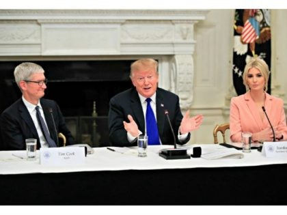 President Donald Trump with American Workforce Policy Advisory Board co-chair Ivanka Trump, right, and Apple Inc. CEO Tim Cook, left, speaks during the advisory board's first meeting in the State Dining Room of the White House in Washington, Wednesday, March 6, 2019. (AP Photo/Manuel Balce Ceneta)