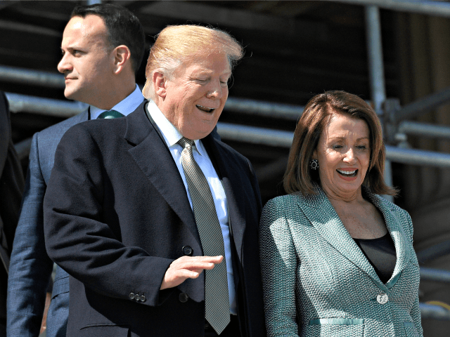 House Speaker Nancy Pelosi of Calif., right, talks with President Donald Trump, center, as Irish Prime Minister Leo Varadkar, left, follows as they walks down the steps of the Capitol in Washington, Thursday, March 14, 2019, following a lunch. (AP Photo/Susan Walsh)