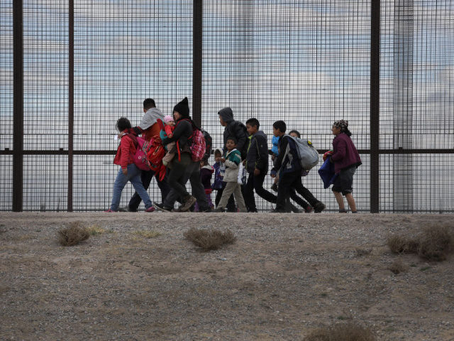 EL PASO, TEXAS - FEBRUARY 01: Central American immigrants walk along the border fence after crossing the Rio Grande from Mexico on February 01, 2019 in El Paso, Texas. The migrants later turned themselves in to U.S. Border Patrol agents, seeking political asylum in the United States. (Photo by John …