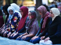 Women pray before iftar, the traditional Ramadan fast-breaking meal, at Lafayette Square during the Muslim holy month of Ramadan on June 6, 2018 in Washington, DC.