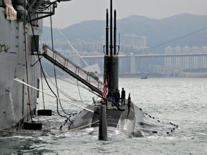 The Los Angeles-class, fast attack submarine USS Hampton (C) sits moored alongside the submarine tender USS Frank Cable (L) during a visit to Hong Kong on May 17, 2011. China is researching and deploying systems to fight U.S. submarines. (Vincent Yu/AFP/Getty Images)