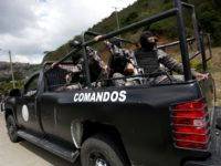 Members of the Venezuelan Bolivarian Intelligence Service arrive to the Junquito highway during an operation to capture Oscar Perez, according to officials, in Caracas, Venezuela, Monday, Jan. 15, 2018. Venezuelan special forces exchanged gunfire Monday with the rebellious police officer who has been on the run since leading a high-profile …