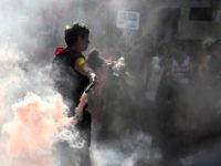 A protester holds a smoke bomb during a march of members of feminist groups and associations defending the rights of lesbian, gay, bisexual and transgender people (LGBT) within the World Congress of Families (WCF) conference on March 30, 2019 in Verona. (Photo by Filippo MONTEFORTE / AFP) (Photo credit should …