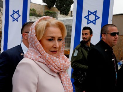 Romanian Prime Minister Viorica Dancila (L) visits the Western Wall, Judaism's holiest worship site, in the old city of Jerusalem on April 26, 2018. (Photo by GALI TIBBON / AFP) (Photo credit should read GALI TIBBON/AFP/Getty Images)