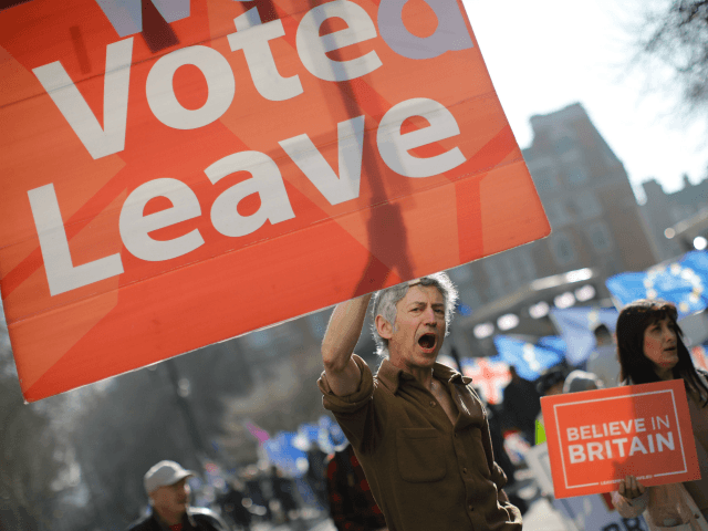 Pro-Brexit activists march outside the Houses of Parliament in central London on February 27, 2019. - Prime Minister Theresa May will today face a vote by MPs over her newly revised Brexit strategy, which allows for a possible request to delay Britain's EU departure if her divorce deal is not …
