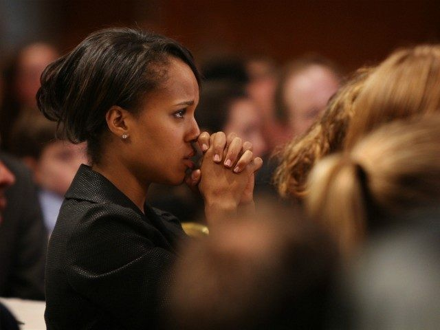 MILWAUKEE - FEBRUARY 16: Actress Kerry Washington listens as Democratic presidential candidate Sen. Barack Obama (D-IL) speaks to members of the Democratic Party of Wisconsin at their Founders Day Dinner at the Midwest Express Center February 16, 2008 in Milwaukee, Wisconsin. Presidential candidate Senator Hillary Clinton (D-NY) also addressed the …