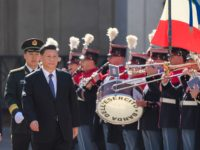Italian President Sergio Mattarella (L) and Chinese President Xi Jinping (C) review a Honour Guard during a welcoming ceremony upon Xi Jinping's arrival for their meeting on March 22, 2019 at the Quirinale presidential palace in Rome, as part of Xi Jinping's two-day visit to Italy. (Photo by Tiziana FABI …