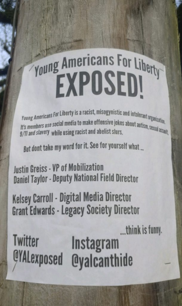 """YAL Exposed"" sign posted on the Tulane campus"