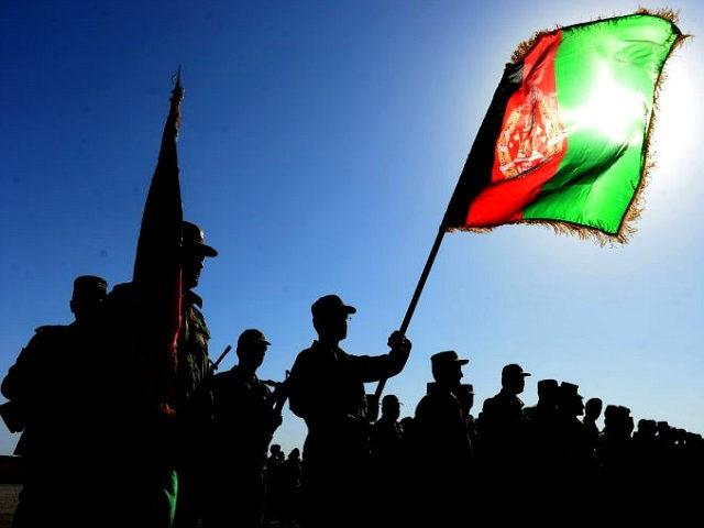 TOPSHOT - Afghan National Army (ANA) soldiers stand to attention during a ceremony at the military base in Herat on July 3, 2016. Around 1000 soldiers trained for 10 weeks during the ANA training progam, after which they are sent on assignments throughout the restive country. / AFP / AREF …