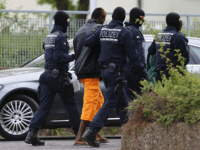 ELLWANGEN, GERMANY - MAY 03: Police and an arrested refugee are seen at the main refugee center during an intervention there by riot police on May 3, 2018 in Ellwangen, Germany. Police raided the facility earlier this morning following a confrontation between police and mostly African refugees four days ago …