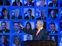 RAMAT GAN, ISRAEL - MARCH 04: Israel's Prime Minster Benjamin Netanyahu points to photos of Likud party members as he delivers a speech during the launch of the Likud party election campaign on March 4, 2019 in Ramat Gan, Israel. (Photo by Amir Levy/Getty Images)