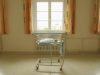 UNDISCLOSED, GERMANY - AUGUST 12: A 4-day-old newborn baby, who has been placed under a window by the photographer, lies in a baby bed in the maternity ward of a hospital (a spokesperson for the hospital asked that the hospital not be named) on August 12, 2011 in a city …