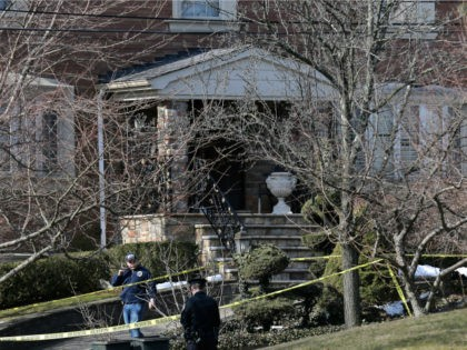 """Police work near the scene where an alleged leader of the Gambino crime family was shot and killed in the Staten Island borough of New York, Thursday, March 14, 2019. Francesco """"Franky Boy"""" Cali, 53, was found with multiple gunshot wounds to his body at his home Wednesday night. (AP …"""
