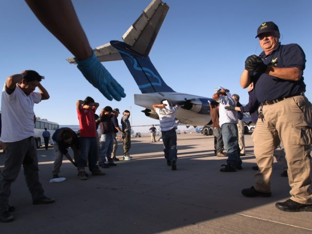 MESA, AZ - JUNE 24: Undocumented Guatemalan immigrants are body searched before boarding a deportation flight to Guatemala City, Guatemala at Phoenix-Mesa Gateway Airport on June 24, 2011 in Mesa, Arizona. The U.S. Immigration and Customs Enforcement agency, ICE, repatriates thousands of undocumented Guatemalans monthly, many of whom are caught …