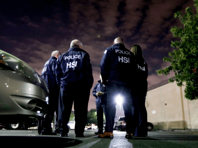 U.S. Immigration and Customs Enforcement agents gather before serving a employment audit notice at a 7-Eleven convenience store Wednesday, Jan. 10, 2018, in Los Angeles. (AP Photo/Chris Carlson)