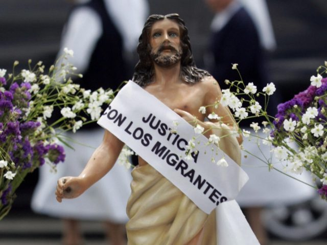 Guatemala City, GUATEMALA: A figure of Jesus which asks for 'justice with the migrants and no more deportations' is pictured in the Constitution Place where members of the Episcopal Conference take part in the Via Crucis of the Migrant in the Historic Centre of Guatemala City, 23 March 2007. The …