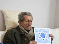 Simon Vrusho, 75-years-old, the founder of the Solomon Jewish history museum in the Albanian city of Berat, speaks with an AFP journalist on February 6, 2019. - The Balkan state is the only Nazi-occupied territory whose Jewish population increased during World War II, thanks to the bravery of ordinary families …