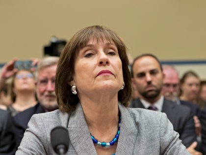FILE - In this May 22, 2013 file photo, Lois Lerner, head of the IRS unit that decides whether to grant tax-exempt status to groups, listens on Capitol Hill in Washington. Lerner, the official at the center of the agency's tea party scandal is retiring. Lerner headed the IRS division …
