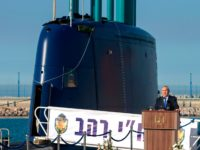 A file picture taken on January 12, 2016 shows Israeli Prime Minister Benjamin Netanyahu delivering a speech during a ceremony for the arrival of the German-made INS Rahav, the fifth Israeli Navy submarine, at the Israeli military port of Haifa. Germany has delayed signing a deal with Israel advancing the …