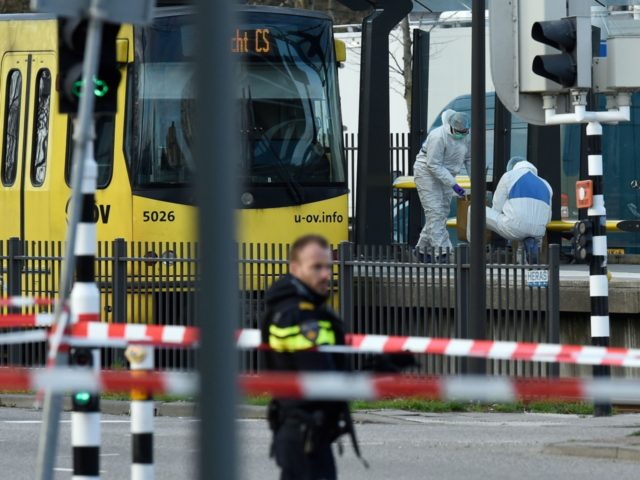 Policemen and rescuers are at work, on March 18, 2019 in Utrecht, near a tram where a gunman opened fire killing at least three persons and wounding several in what officials said was a possible terrorist incident. (Photo by JOHN THYS / AFP) (Photo credit should read JOHN THYS/AFP/Getty Images)