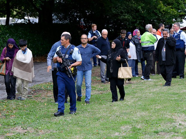 Police escort witnesses away from a mosque in central Christchurch, New Zealand, Friday, March 15, 2019. Multiple people were killed in mass shootings at two mosques full of people attending Friday prayers, as New Zealand police warned people to stay indoors as they tried to determine if more than one …