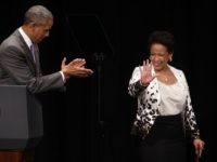 U.S. Attorney General Loretta Lynch (R) waves as President Barack Obama (L) applauds as they arrive at a formal investiture ceremony June 17, 2015 at the Warner Theatre in Washington, DC. Lynch was officially sworn in by Vice President Joe Biden as the 83rd Attorney General of the United States …