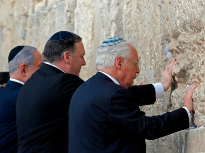 (L to R) Israeli Prime Minister Benjamin Netanyahu, US Secretary of State Mike Pompeo, and US ambassador to Israel David Friedman, touch the stones of the Western Wall in Jerusalem's Old City on March 21, 2019, during the second day of Pompeo's visit as part of his five-day regional tour …