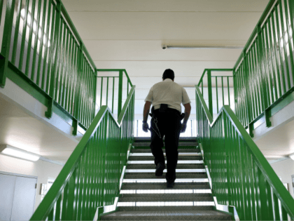 WREXHAM, WALES - MARCH 15: A prison guard walks through a cell area at HMP Berwyn on March 15, 2017 in Wrexham, Wales. The mainly category C prison is one of the biggest jails in Europe capable of housing around to 2,100 inmates. (Photo by Dan Kitwood/Getty Images)