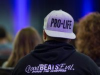 WASHINGTON, DC - JANUARY 17: A pro-life supporter wears a hat at a youth rally during the 2019 March for Life Conference and Expo on January 17, 2019 in Washington, DC. (Photo by Zach Gibson/Getty Images)