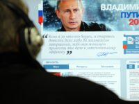 A man looks at a computer monitor displaying the main page of Russian Prime Minister Vladimir Putin's election campaign website, Moscow, on January 12, 2012. In his manifesto for March 2012 presidential elections Putin vowed today to end repressive police behaviour in Russia but also warned that Moscow would retaliate …