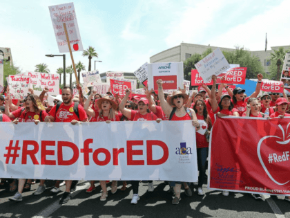 Arizona teachers turned out in Red for Ed shirts during their strike that ended this month. |Ralph Freso/Getty Images