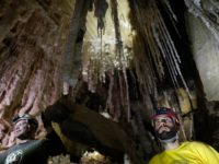 Boaz Langford (R), Member of HUs Cave Research Center and head of the Malham Cave Mapping Expedition, along with Yoav Negev (L), chairman of the Israel Cave Explorers Club and project leader of the Malham Cave Mapping Expedition, show journalists salt stalactites in the Malham cave inside Mount Sodom, located …