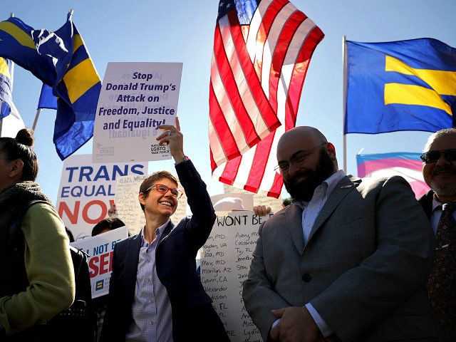 WASHINGTON, DC - OCTOBER 22: L.G.B.T. activists from the National Center for Transgender Equality, partner organizations and their supporters hold a 'We Will Not Be Erased' rally in front of the White House October 22, 2018 in Washington, DC. Members of the L.G.B.T. community and their supporters across the country …