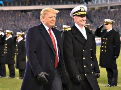 """President Donald Trump, seen with Naval Academy Superintendent Vice Adm. Ted Carter at the Army-Navy football game Saturday, suggested the new figure as a """"negotiating tactic,"""" according to a source. 