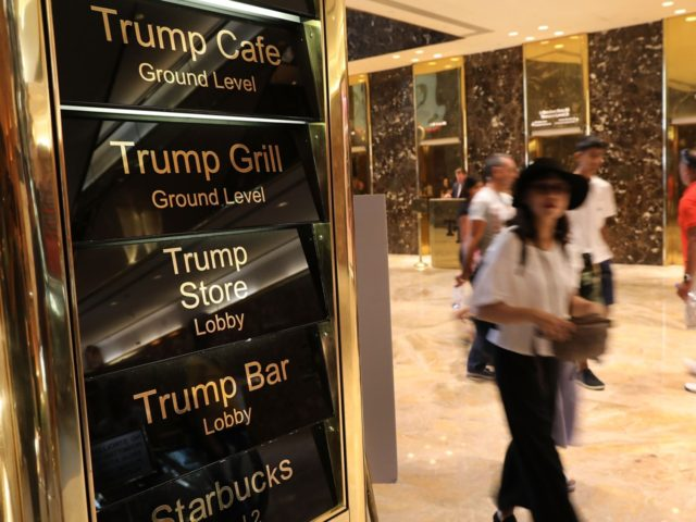 People walk through Trump Tower on Fifth Avenue in Manhattan on August 24, 2018 in New York City. Following new allegations over hush money that former Trump attorney Michael Cohen paid to an adult-film actress, the Manhattan district attorneyÕs office in New York City may seek criminal charges against the …