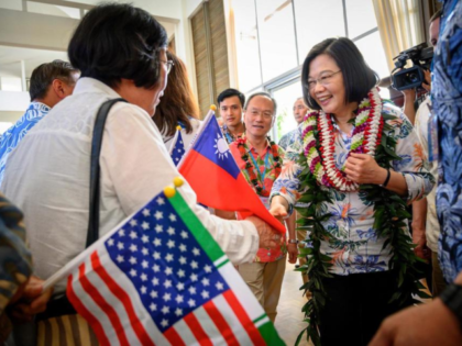 In this Wednesday, March 27, 2019, photo released by the Taiwan Presidential Office, Taiwanese President Tsai Ing-wen, right, is greeted by supporters upon arriving in Hawaii. Speaking during the visit to Hawaii on Wednesday, Tsai said requests have been submitted to the U.S. for F-16V fighters and M1 Abrams tanks. …